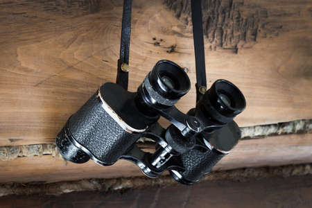 antique binoculars: an old pair of binoculars on a wooden wall