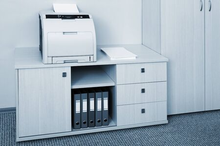 file cabinet: printer from the cabinet in a modern office Stock Photo