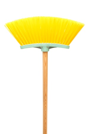 yellow brush the floor on a white background photo