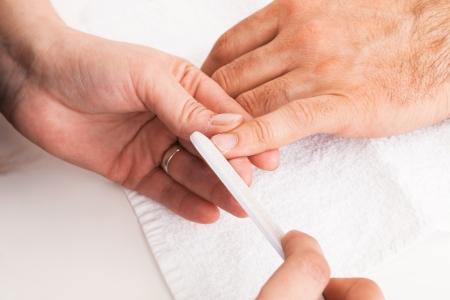 man's thumb: Manicure man close-up to the beauty salon