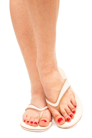 female feet in sandals on a white background photo