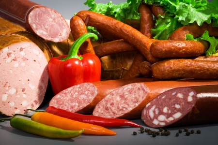still life of sausages, ham and peppers