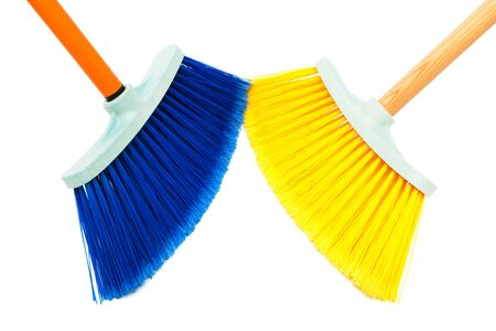 two brush the floor on a white background photo