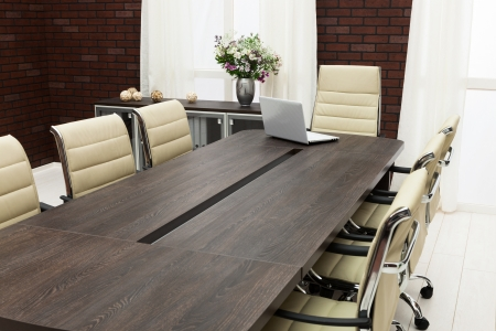 table for negotiations with the laptop in the office