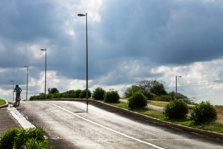 bicyclist on the asphalt road on a summer day Stock Photo - 16941966