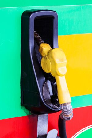 Refueling hose at modern petrol gas station photo