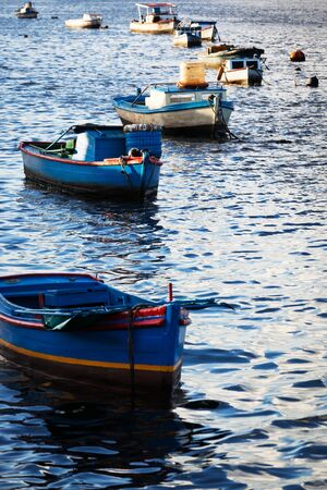 Fishing boats in the bay ocean photo