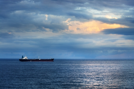 cargo ship in the ocean in the sky photo