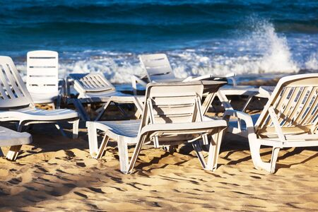 deckchairs on a beach on a background of ocean Stock Photo - 17190880