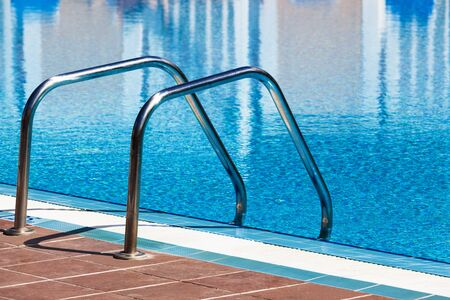 metal railings stairs pool with reflection Stock Photo - 17277263
