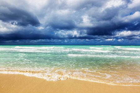 Storm clouds over sandy beach Stock Photo - 17439545