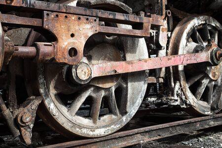 railway history: rusty wheels of old steam locomotive close up Stock Photo