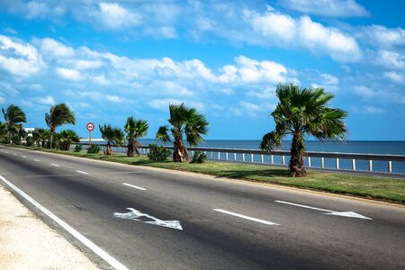 road by the sea on a sunny day photo