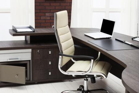 laptop on a desk in a modern office