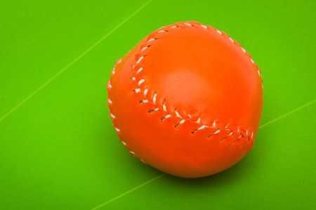 Baseball ball on a green background photo