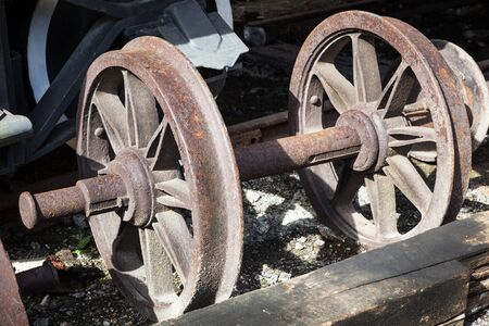 rusty wheels of old steam locomotive close up photo