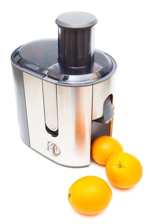 Juicer and oranges on a white background photo
