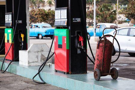 barrel tile: Refueling hose at modern petrol gas station