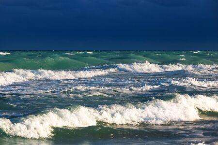 storm tide: Dark stormy sky over the ocean
