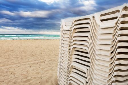 trestle: White trestle beds on the beach