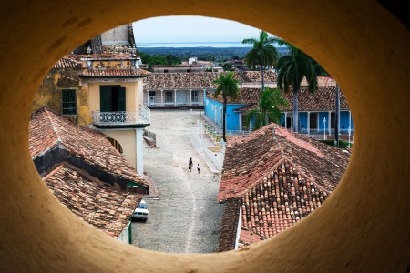 rooftiles: oval window with a view of the old Trinidad Stock Photo