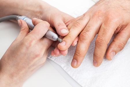 Manicure man close-up to the beauty salon photo