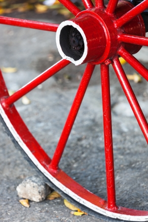 red wooden wheel on the road photo