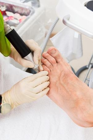 pedicure foot in a modern beauty salon photo