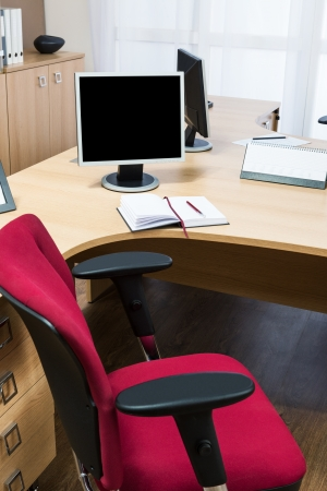 monitors on a desk in a modern office Stock Photo - 21494745