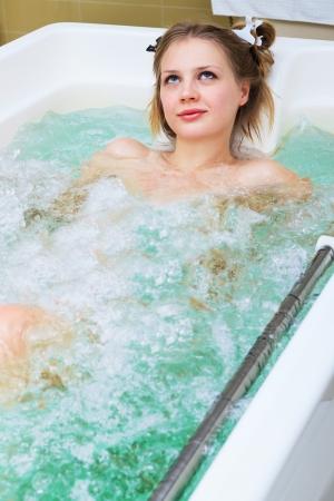 girl in jacuzzi in a beauty salon photo