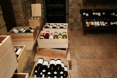storage compartment: Bottles with old wine in liquor store Stock Photo