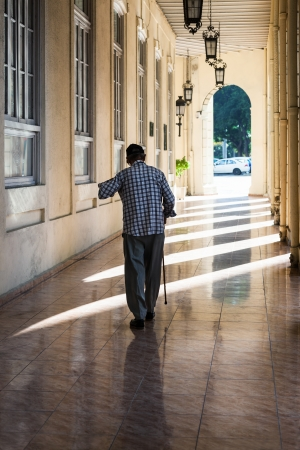an old man with a cane on the sidewalk Stock Photo - 22925804