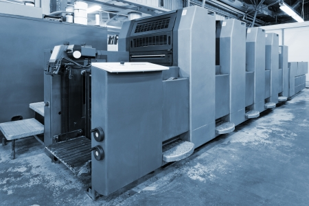 old equipment for printing in a modern printing house photo