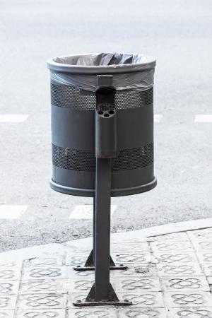 clean street: metal wheelie bin on the sidewalk Stock Photo