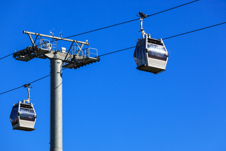 cable railway on a background of blue sky photo