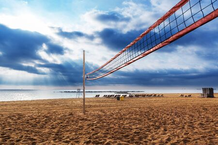 beach volleyball: net for beach volleyball at sunrise Stock Photo