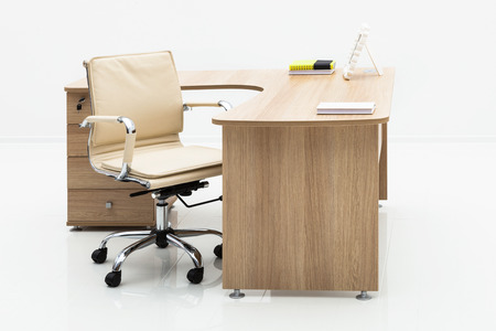 office furniture: wood table and chair on a white wall