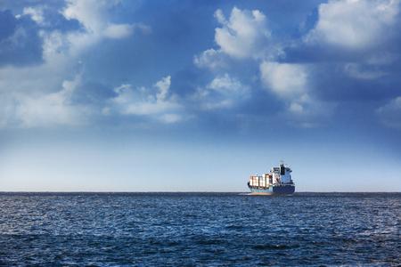 sea horizon: cargo ship in the ocean in the sky