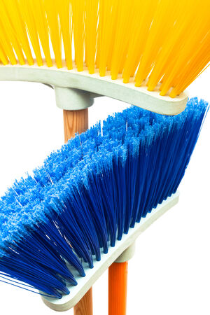 blue and yellow brush the floor on a white background photo