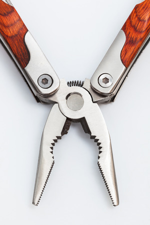 folding knife with pliers close up photo