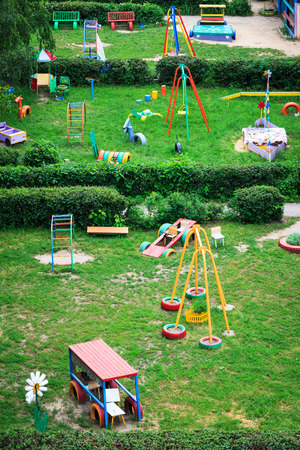childrens playground in the garden on a sunny day photo