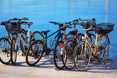 rack wheel: bicycle parking on the sea background Stock Photo