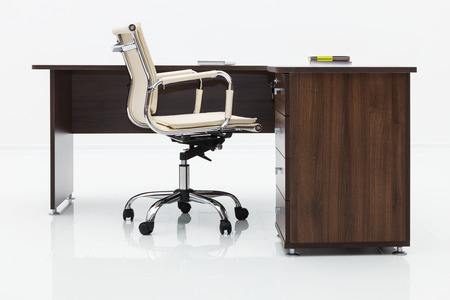 wood desk and chair on a white wall photo