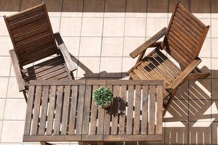 folding chair: folding chair and table on a sunny day