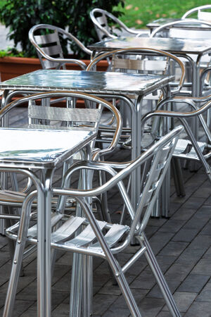 aluminum tables and chairs in a cafe on the street photo
