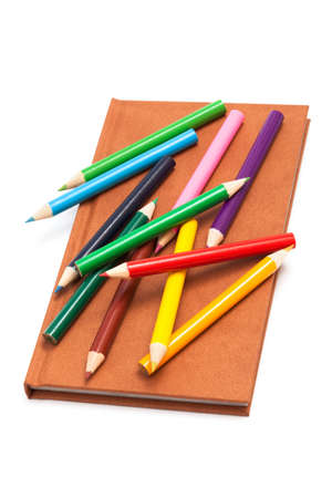 pencils and notebook on a white background photo