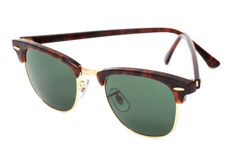 new sunglasses on a white background photo
