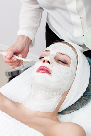medical procedure: laying of mudpack in modern beauty salon