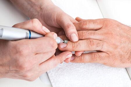 manicure man in a beauty salon photo