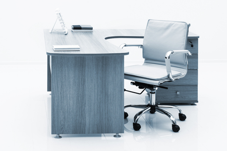 empty chair: desk with drawers on a white wall